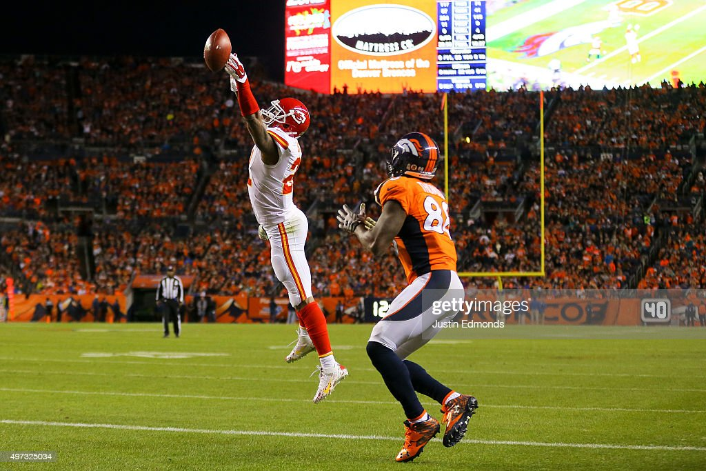 Cornerback Sean Smith #21 of the Kansas City Chiefs deflects a ball intended for wide receiver Demaryius Thomas #88 of the Denver Broncos during the fourth quarter at Sports Authority Field Field at Mile High on November 15, 2015 in Denver, Colorado. The Chiefs defeated the Broncos 29-13.
