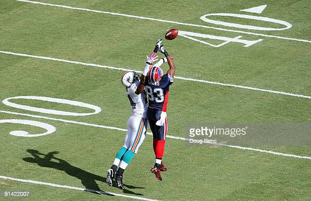 Cornerback Sean Smith of the Miami Dolphins defends a pass intended for wide receiver Lee Evans of the Buffalo Bills at Land Shark Stadium on October...