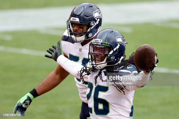 Cornerback Shaquill Griffin of the Seattle Seahawks celebrates after intercepting a pass against the Washington Football Team in the first half at...