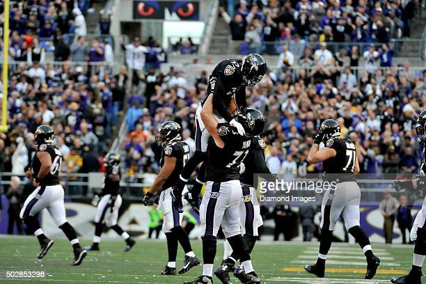 Cornerback Shareece Wright and guard Marshall Yanda of the Baltimore Ravens celebrate a fourth down stop during a game against the Pittsburgh...