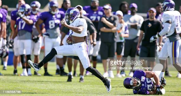 Cornerback Shaun Prater high stepped away from Chase Ford after intercepting a pass during Vikings training camp at Minnesota State University...