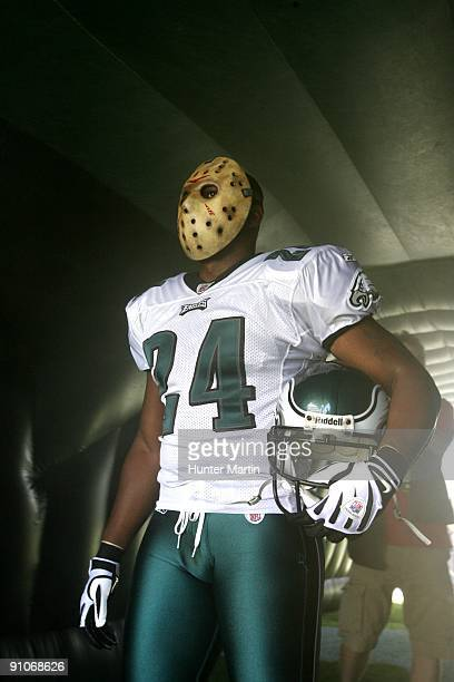 """Cornerback Sheldon Brown of the Philadelphia Eagles stands in the players tunnel wearing a """"Jason"""" mask before a game against the New Orleans Saints..."""