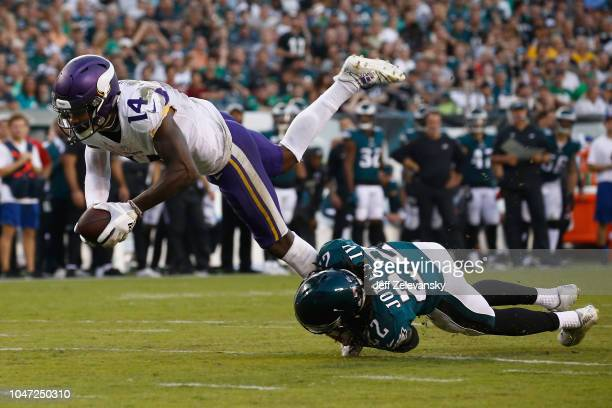 Cornerback Sidney Jones of the Philadelphia Eagles tackles wide receiver Stefon Diggs of the Minnesota Vikings during the third quarter at Lincoln...