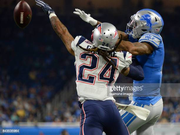 Cornerback Stephon Gilmore of the New England Patriots deflects a pass intended for wide receiver Marvin Jones Jr #11 of the Detroit Lions in the...