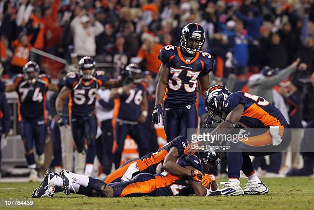 Cornerback Syd'Quan Thompson of the Denver Broncos falls on the ball after he intercepted quarterback Matt Schaub of the Houston Texas late in the...