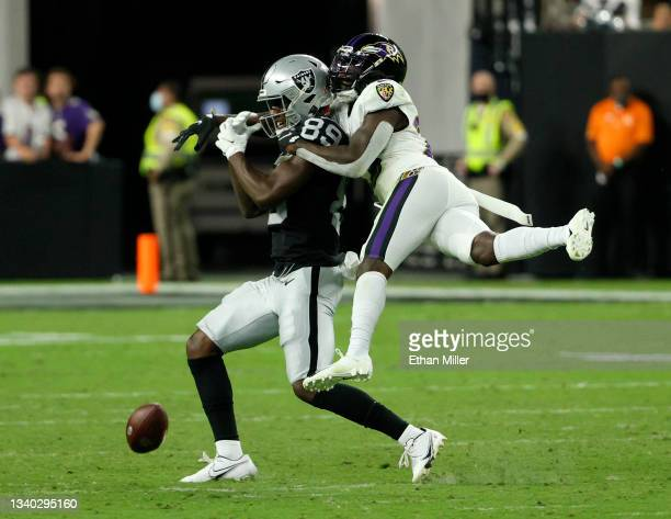 Cornerback Tavon Young of the Baltimore Ravens is called for pass interference as he defends against a pass to wide receiver Bryan Edwards of the Las...