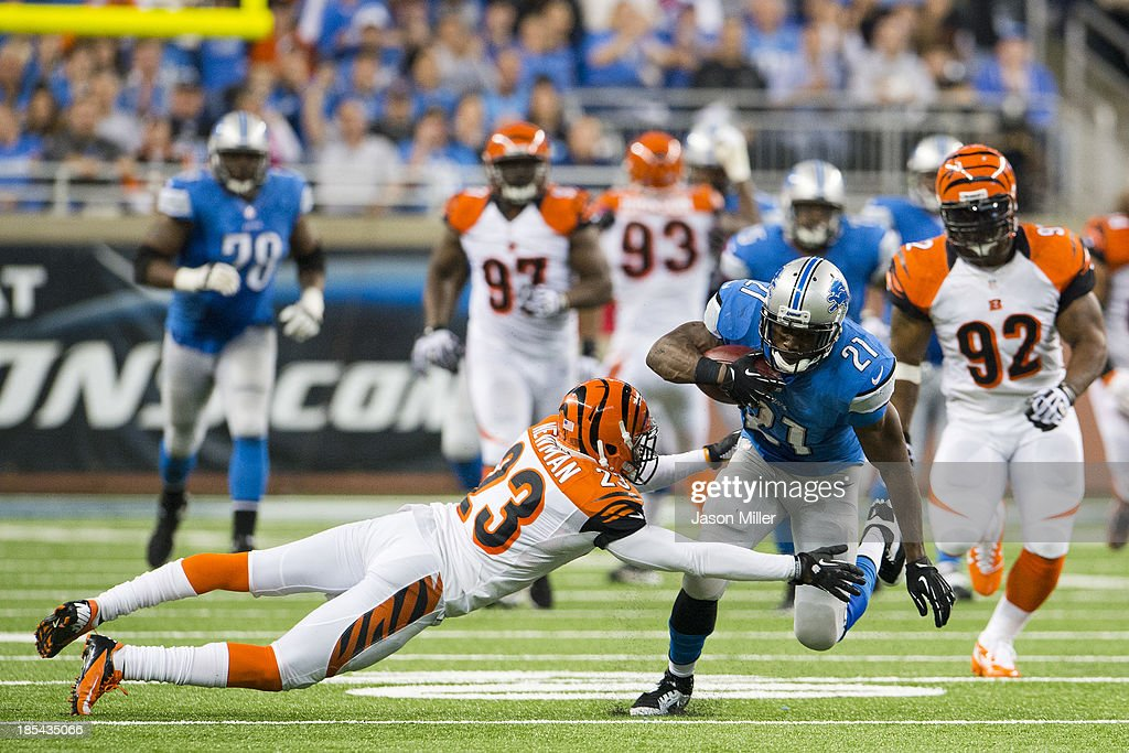 Cornerback Terence Newman #23 of the Cincinnati Bengals tackles running back Reggie Bush #21 of the Detroit Lions as Bush runs for a first down during the second half at Ford Field on October 20, 2013 in Detroit, Michigan. The Bengals defeated the Lions 27-24.