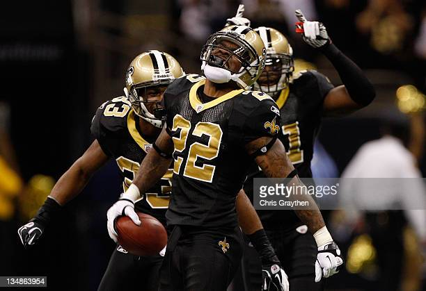 Cornerback Tracy Porter of the New Orleans Saints celebrates with teammates strong safety Roman Harper and cornerback Jabari Greer after an...