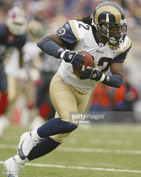 Cornerback Travis Fisher of the St. Louis Rams runs upfield against the Buffalo Bills on November 21, 2004 at Ralph Wilson Stadium in Orchard Park,...