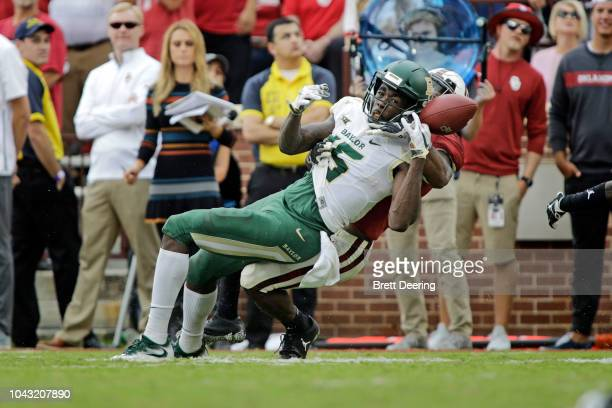 Cornerback Tre Brown of the Oklahoma Sooners breaks up a pass to wide receiver Denzel Mims of the Baylor Bears at Gaylord Family Oklahoma Memorial...