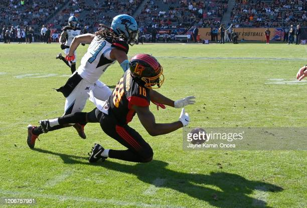 Cornerback Treston Decoud of the Dallas Renegades is called for interference on a pass intended for wide receiver Adonis Jennings of the Los Angeles...