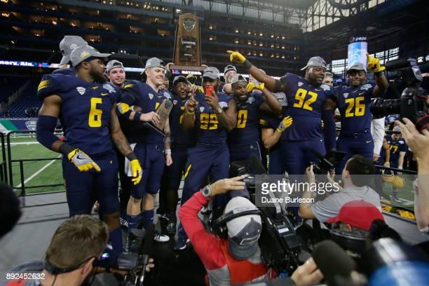 Cornerback Trevon Mathis of the Toledo Rockets celebrates with quarterback Logan Woodside defensive lineman Tuzar Skipper linebacker Ja'Wuan Woodley...