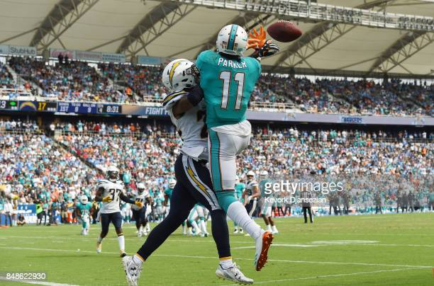 Cornerback Trevor Williams of the Los Angeles Chargers breaks up a touch down pass to wide receiver DeVante Parker of the Miami Dolphins during the...