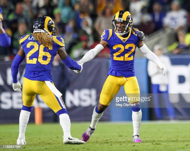 Cornerback Troy Hill of the Los Angeles Rams celebrates with defensive back Marqui Christian after catching a pass intended for wide receiver Tyler...