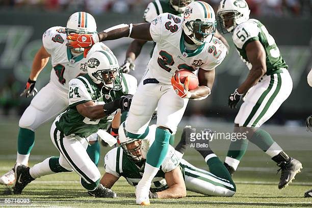 Cornerback Ty Law of the New York Jets attempts to tackle running back Ronnie Brown of the Miami Dolphins on September 18 2005 at Giants Stadium in...