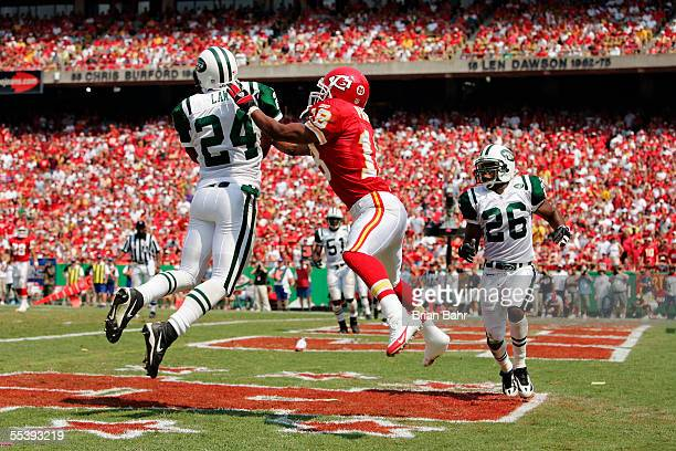 Cornerback Ty Law of the New York Jets intercepts a pass intended for shoeless wide receiver Samie Parker of the Kansas City Chiefs on September 11...