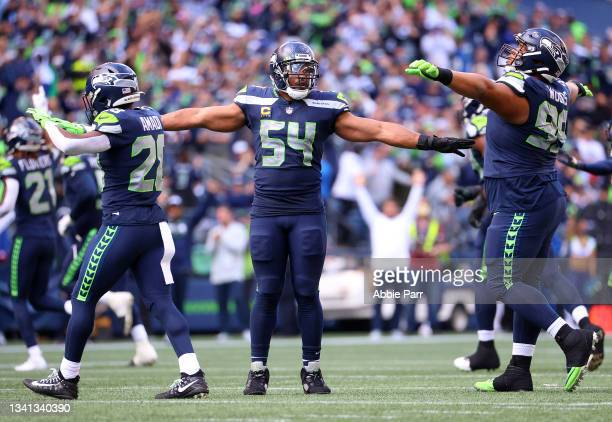 Cornerback Ugo Amadi, middle linebacker Bobby Wagner, and defensive tackle Al Woods of the Seattle Seahawks react to a missed field goal by the...