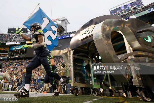 Cornerback Ugo Amadi of the Seattle Seahawks carries a flag before an NFL preseason game against the Denver Broncos at Lumen Field on August 21, 2021...