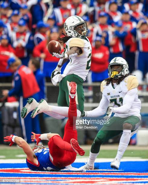 Cornerback Verkedric Vaughns of the Baylor Bears attemptes to intercept the ball against the Kansas Jayhawks during the first half at Memorial...