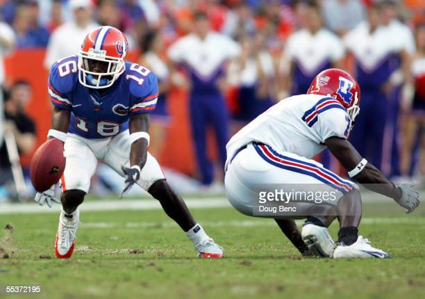 Cornerback Vernell Brown of the University of Florida Gators just misses an interception over wide receiver Johnathan Holland of the Louisiana Tech...