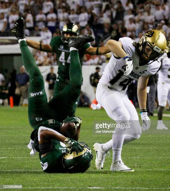 Cornerback VJ Banks of the Colorado State Rams intercepts a pass intended for wide receiver Jay MacIntyre of the Colorado Buffaloes in the second...