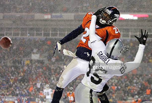 Cornerback Willie Middlebrooks of the Denver Broncos is called for pass interference in the endzone on this play as he bats down a pass against wide...
