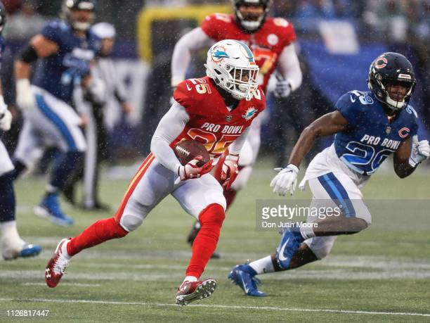 Cornerback Xavien Howard of Miami Dolphins from the AFC Team makes an interception and is pursued by Runningback Tarik Cohen of the Chicago Bears...