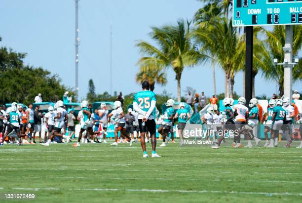 Cornerback Xavien Howard of the Miami Dolphins watches practice drills from a distance during Training Camp at Baptist Health Training Complex on...