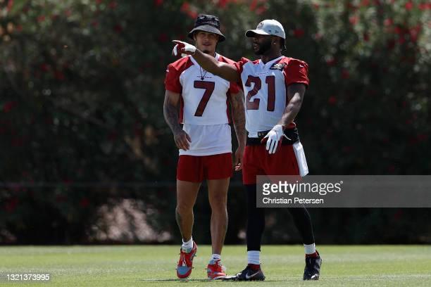 Cornerbacks Byron Murphy Jr. #7 and Malcolm Butler of the Arizona Cardinals participate in an off-season workout at Dignity Health Arizona Cardinals...