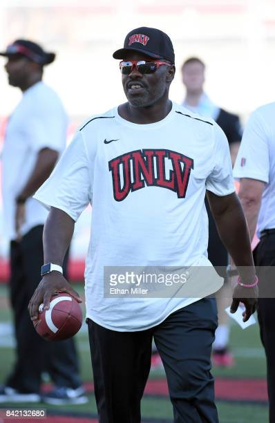 Cornerbacks coach David Lockwood of the UNLV Rebels watches the team warm up before a game against the Howard Bison at Sam Boyd Stadium on September...