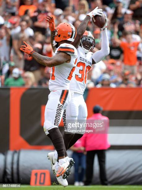 Cornerbacks Jason McCourty and Jamar Taylor of the Cleveland Browns celebrate an interception by McCourty in the second quarter of a game on October...