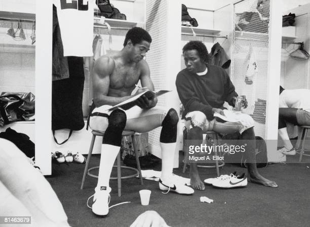 Cornerbacks Mike Haynes and Lester Hayes of the Los Angeles Raiders go over strategy in the locker room before a game against the Atlanta Falcons at...