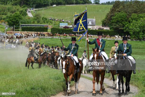 Cornet Gareth James Renwick and his equestrian supporters leave St Leonards to ride the outlying marches during the CommonRiding on June 8 2018 in...