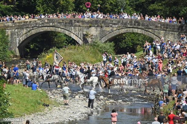 Cornet Iain Little with his right and lefthand men Stuart Murray and Simon Tweddletake part in the Langholm Common Riding on July 26 2018 in Langholm...