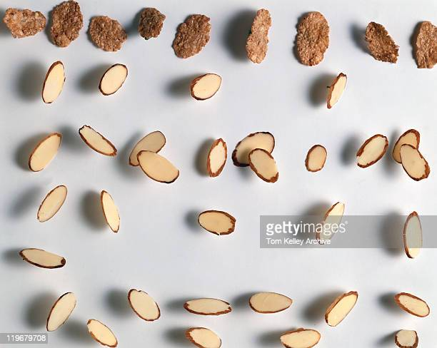 Cornflakes and almond slices on white background