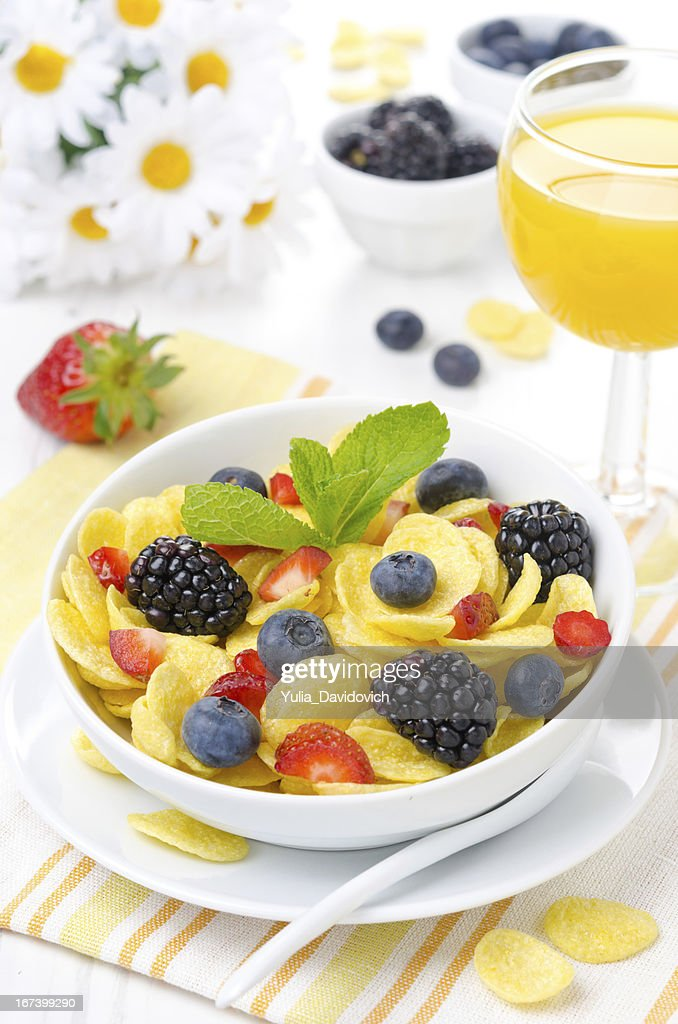 Cornflakes, fresh berries and orange juice for breakfast : Stock Photo