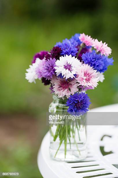 Cornflowers in glass