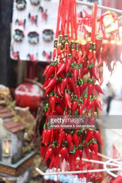 cornicellos for sale in naples, italy - portafortuna foto e immagini stock