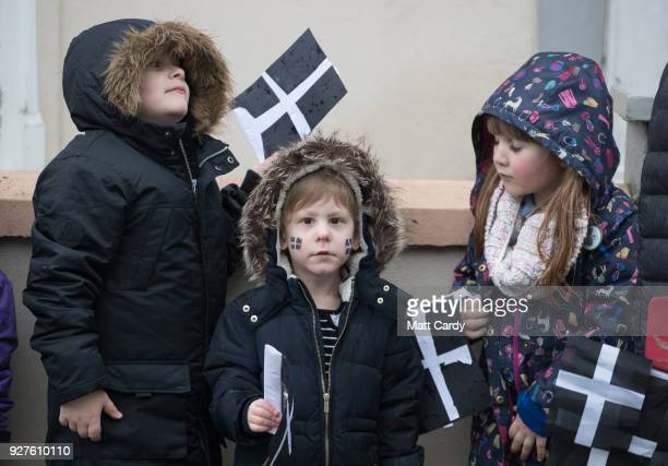 Cornish flags are waved by school children attending the St Piran's Day march which celebrates St Piran patron saint of tinners and regarded by many...