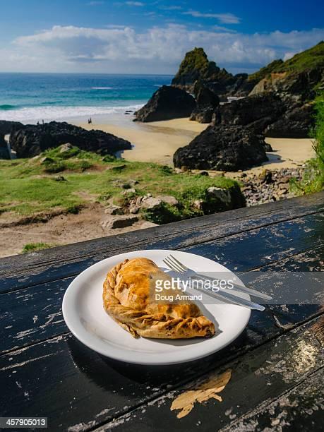 cornish pasty on plate in outdoor setting - cornish pasty stock-fotos und bilder