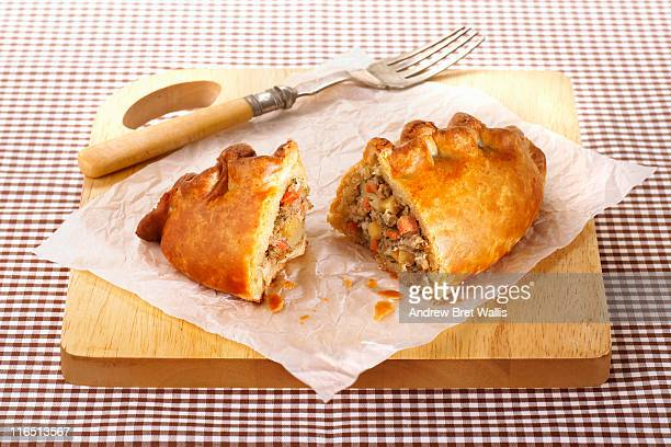 cornish pasty opened to show filling - cornish pasty stock-fotos und bilder