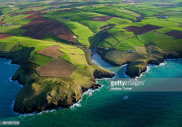 cornish quilt - coastline stock photos and pictures