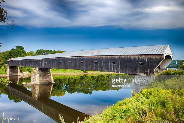 cornish-windsor covered bridge in vermont - covered bridge stock photos and pictures