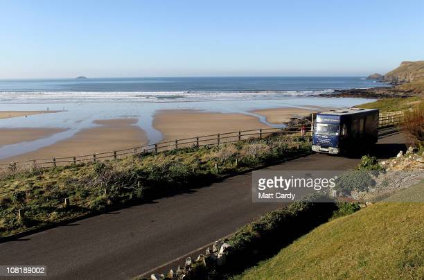 Cornwall County Council mobile library driver and assistant Andrew Reeves drives the council's mobile library lorry along the sea front at Polzeath...