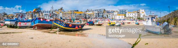 cornwall st ives fishing boats and tourists beach harbour panorama - cornwall england stock pictures, royalty-free photos & images