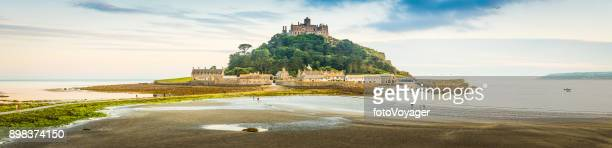 cornwall st michaels mount overlooking beach causeway seaside panorama uk - st michael's mount stock pictures, royalty-free photos & images