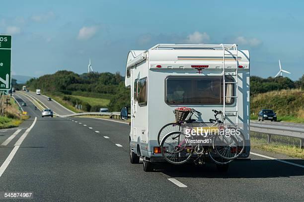 UK, Cornwall, Tintagel, Caravan with bike rack on country road