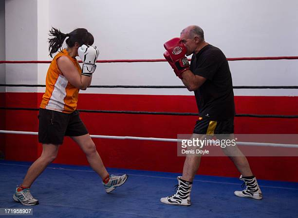 Coro Suarez a 42yearold civil servant spars with a male colleague at the Gabriel Campillo boxing gym on June 25 2013 in Madrid Spain Spanish women...