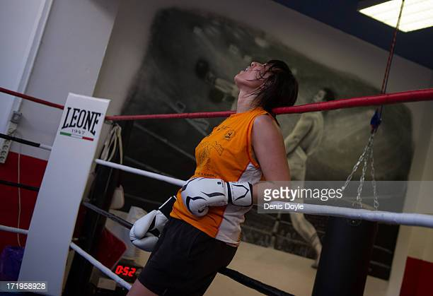 Coro Suarez a 42yearold civil servant takes a break from sparring with a male colleague at the Gabriel Campillo boxing gym on June 25 2013 in Madrid...
