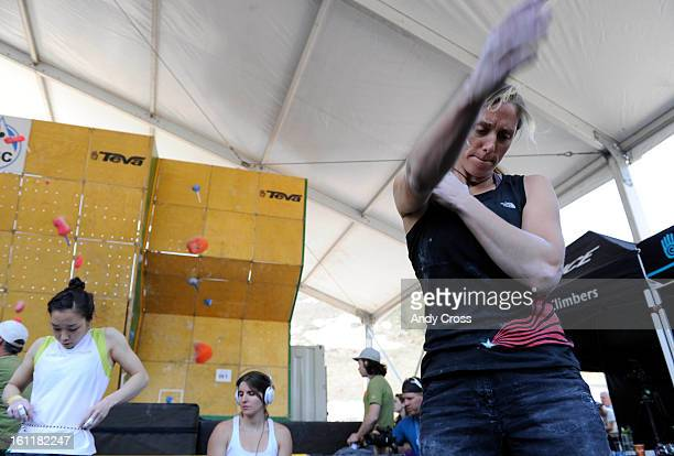 Rock climber, Alex Johnson, USA, loosens up her arms before making another attempt at the wall during the IFSC Bouldering World Cup semi-finals at...